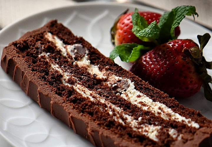 a slice of flourless chocolate cream cake on a plate