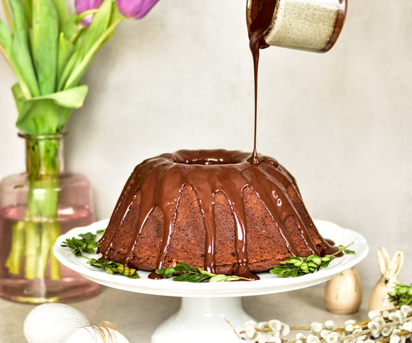 chocolate orange bundt cake on a cake plate