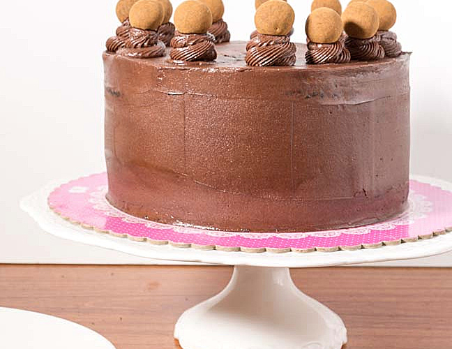 gluten-free chocolate cake on a cake plate