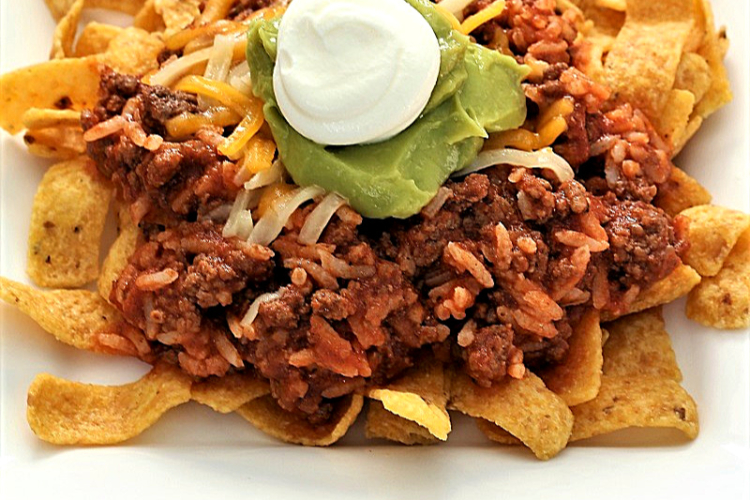 ground beef and rice over corn chips
