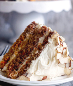 a slice of carrot cake on a plate
