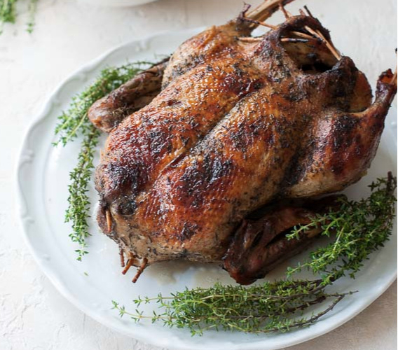 Roasted duck on a platter