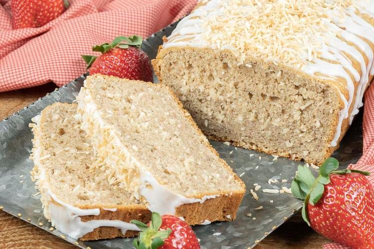 sliced, spiced coconut loaf on a platter