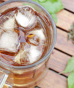 tulsi iced tea in a glass with ice cubes