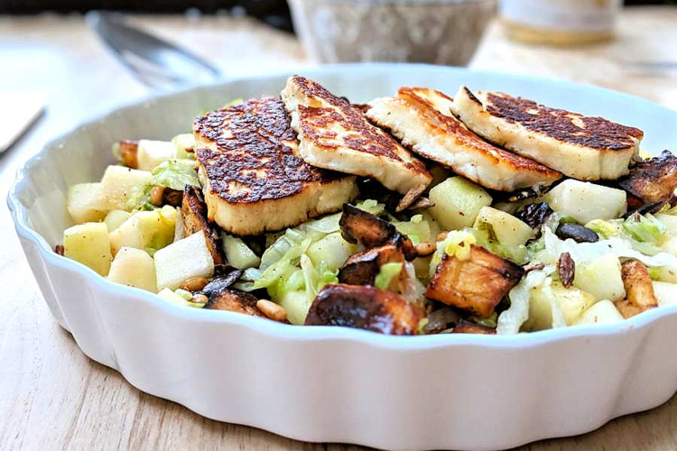 Pear and grilled haloumi salad in a dish
