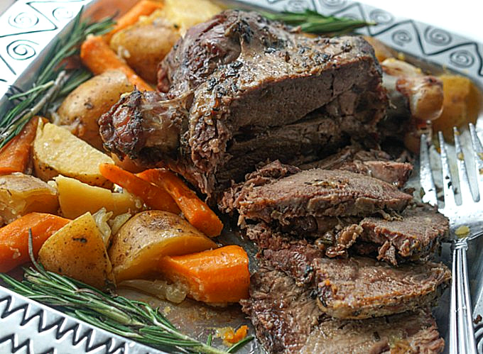 sliced lamb and veggies on a platter