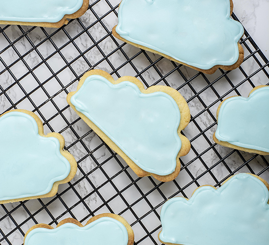 Rainy day cloud cookies on a cooling rack