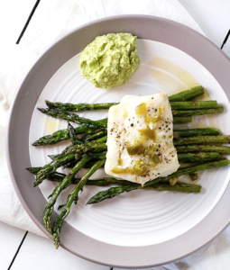 Roasted Cod with Asparagus and Jalapeño Dressing on a plate