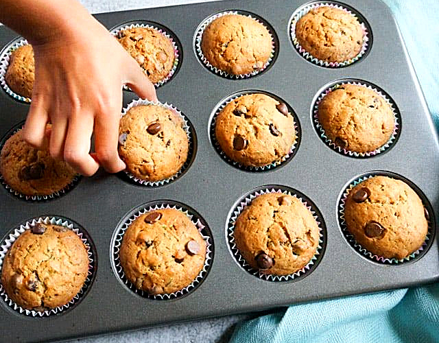 chocolate chip zucchini muffins in a muffin pan
