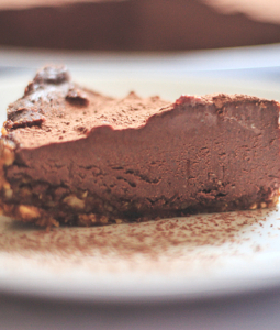 a slice of vegan chocolate cheescake on a plate
