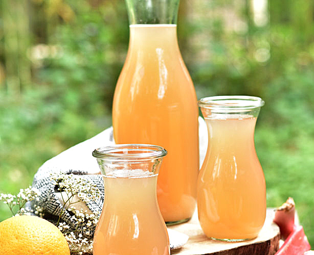 rhubarb lemonade in a bottle and in 2 glasses