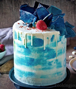 tall vanilla cake with frosting