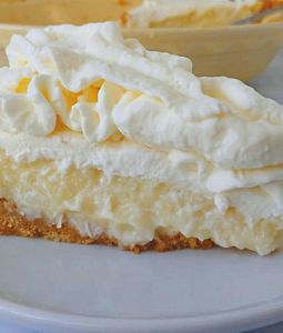 a slice of coconut cream pie on a plate